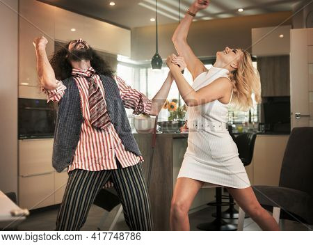 Funny couple spending time together at home