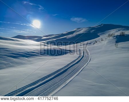 Cross Country Skiing Slope Running Though Stunning Snow Covered Mountain Terrain On A Cold Sunny Win