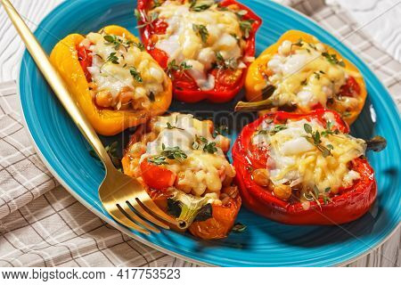 Chickpea Stuffed Peppers Are Filled With Tomatoes, Thyme And Spices And Topped With Melted Cheddar A