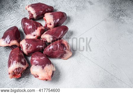 Raw Turkey Hearts Offal. White Background. Top View. Copy Space