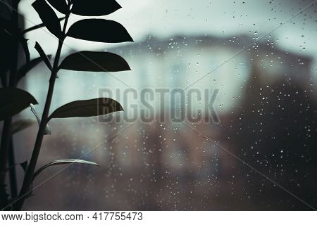 Rainy, Cloudy Weather Outside The Window. Raindrops On Glass, Inside View. Selective Focus