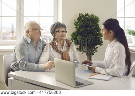 Old Senior Couple Contract Meeting Financial Adviser Bank Manager For Investment