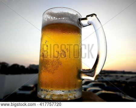 Bubbles In The Beer In The Glass. The Beer Is Poured Into A Beer Glass And It Flows In Foam In A Gla