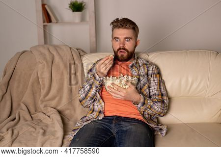 Single Man On The Couch Watching Tv