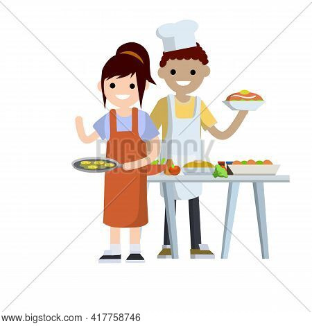 Family Cooks In Kitchen. Man Cook In White Apron Holding Plate Of Delicious. Woman Waiter In Red Fry