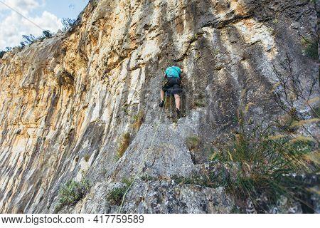 Climber Climbs On The Rock Wall. Climbing Gear. Climbing Equipment.
