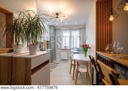 Modern luxury kitchen interior with dining zone