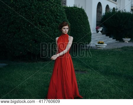 Woman In Luxury Red Dress Walk Outdoors Masquerade Gothic Style