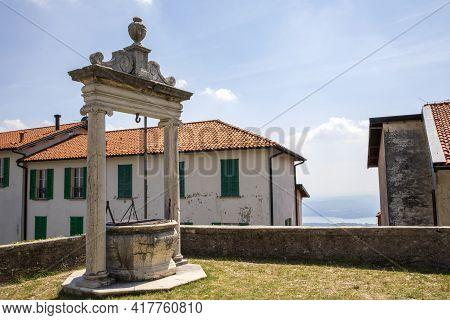 Sacro Monte (va), Italy - June 01, 2020: Water Well At Pilgrimage Village Of Santa Maria Del Monte O