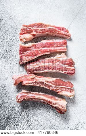 Raw Sliced Veal Spare Loin Ribs. White Background. Top View
