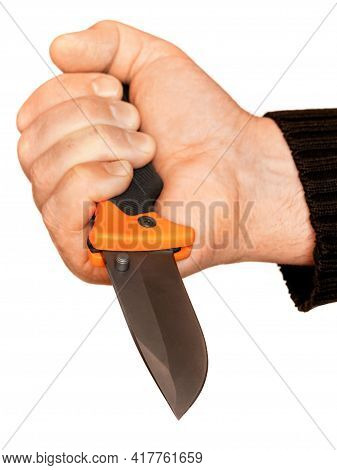 The Man Holds A Hunting Knife And Ready To Attack. A Knife In A Man's Hand For Attack Or Defense