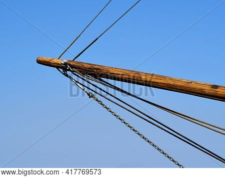 Bowsprit Made Of Wood And Gathered Sail Of A Large Classical Traditional Vintage Tall Sailing Ship