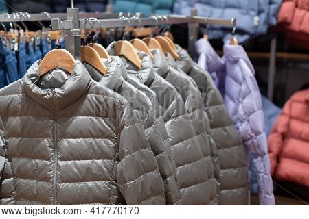 Women S Clothing Store. Puffers And Jackets In The Off Season Hangers In The Boutique Trading Hall