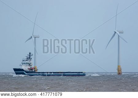Supply Vessel For Green Energy Industry Offshore Wind Turbine Development. Close-up Of A Tug Ship Sa
