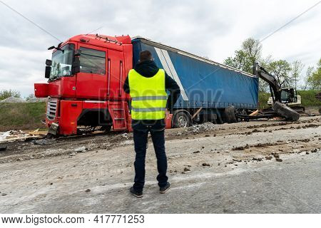 Highway Road Freight Lorry Accident. Crashed Broken Cargo Semi Trailer Truck On Freeway Roadside And