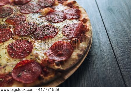 Pepperoni Pizza With Mozzarella Cheese, Salami, Pepper On A Wood Table.