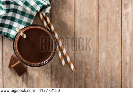 Chocolate Milkshake In Glass On Wooden Table. Top View. Copy Space