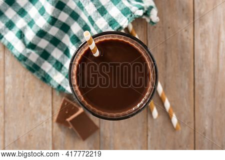 Chocolate Milkshake In Glass On Wooden Table. Top View