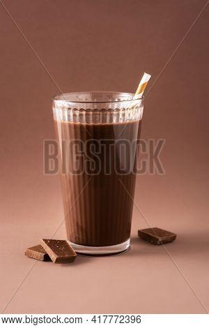 Chocolate Milkshake In Glass On Brown Background