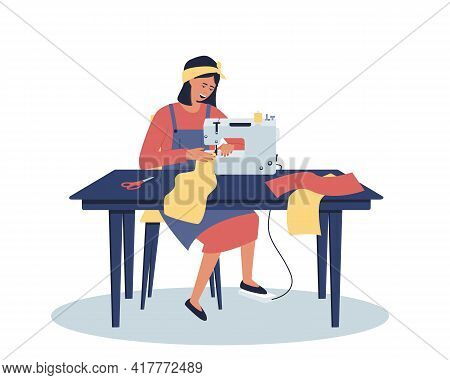 A Woman Works At Home At Her Desk. A Seamstress At Home Works On A Sewing Machine. Distant Work. A U