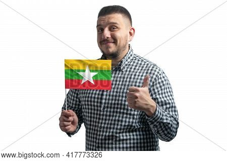 White Guy Holding A Flag Of Myanmar And Shows The Class By Hand Isolated On A White Background. Like