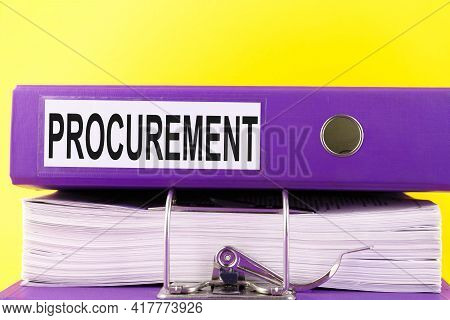 The Procurement Text Is Written On An Office Folder On A Pile Of Papers With A Yellow Background. Co