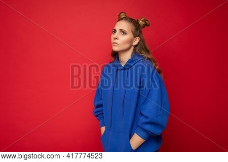 Portrait Of Sorrowful Tired Young Attractive Winsome Blonde Woman With Two Horns With Sincere Emotio