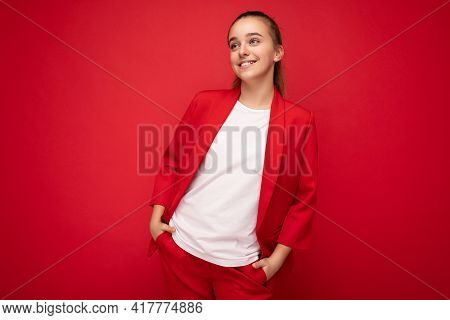 Shot Of Charming Positive Smiling Brunette Little Female Teenager Wearing Trendy Red Jacket And Whit