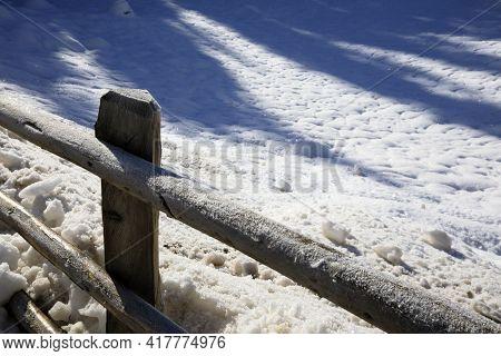 Carezza Lake (bz), Italy - December 01, 2019: The Wooden Fence Around Carezza Lake, Nova Levante, Bo