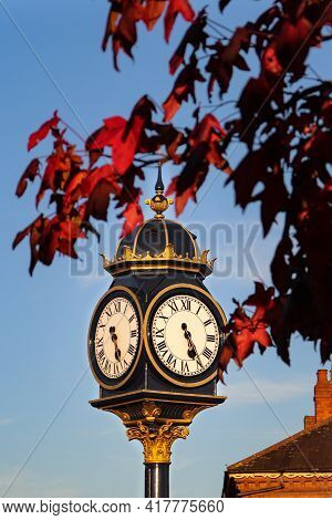 The Autumn Clock Downtown With The Clear Blue Sky As A Background
