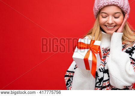Closeup Photo Shot Of Beautiful Happy Smiling Surprised Young Blonde Woman Isolated Over Red Backgro