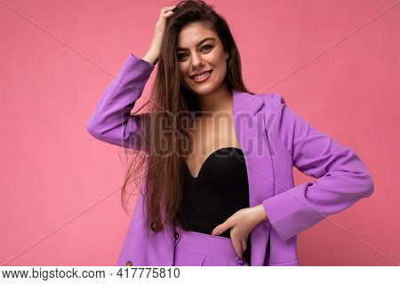 Photo Of Smiling Young Business Woman Wearing Purple Suit Isolated On Background. Copy Space