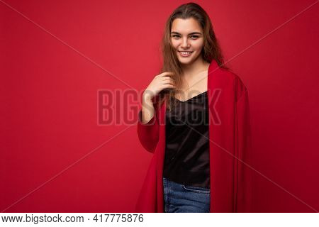 Young Beautiful European Stylish Brunette Woman Wearing Black Blouse Top And Red Cardigan Isolated O