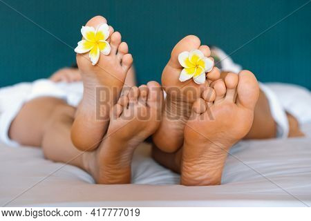 Spa Treatment And Product For Woman Hands And Foot Spa. Foot With Tropical Flowers.
