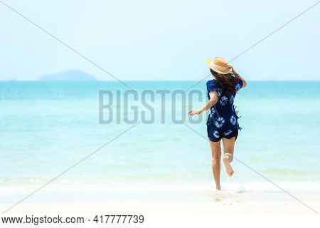 Summer Vacations. Lifestyle Woman Relax And Chill On Beach Background.  Asia Happy Young People Runn