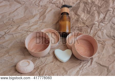On A Paper Background There Are Two Empty Round Birch Bark Boxes, A Diffuser, A Round Piece Of Balm