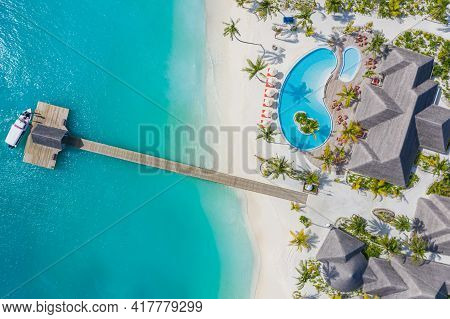 Top Aerial View. Luxurious Beach Resort With Swimming Pool And Villas, Bungalows With Palm Trees And