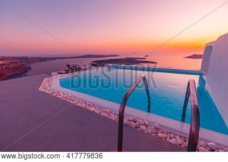 Amazing Evening Landscape, Infinity Pool Caldera View Santorini, Greece With Stunning Sunset. Cloudy
