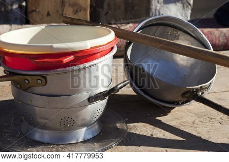 Dulzago (no), Italy - January 29, 2017: Colander, Buckets And Ladles Used For The Feast Of The Patro