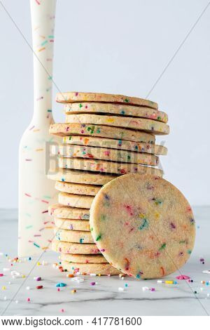 A Stack Of Sprinkle Sugar Cookies With A Sprinkle Designed Rubber Spatula Standing Beside And Sprink