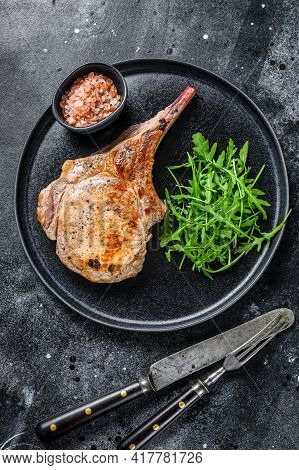 Grilled Pork Chop Loin Meat Steak On A Marble Board. Black Background. Top View