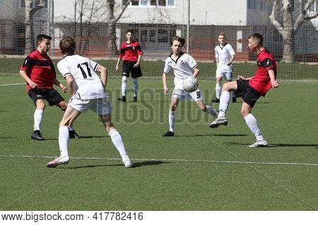 Odessa, Ukraine - April 7, 2021: Local Children's Football Teams U-14 Play On Artificial Grass Of St