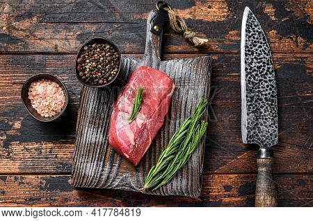 Raw Veal Sirloin Meat Steak On A Wooden Board. Wooden Background. Top View