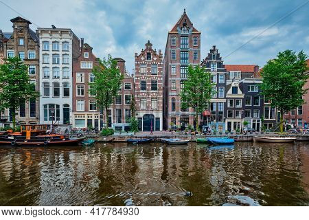 Singel canal in Amsterdam with houses. Amsterdam, Netherlands