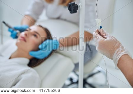 Picture Of Arms Beautician With Iv Infusion In Spa Center