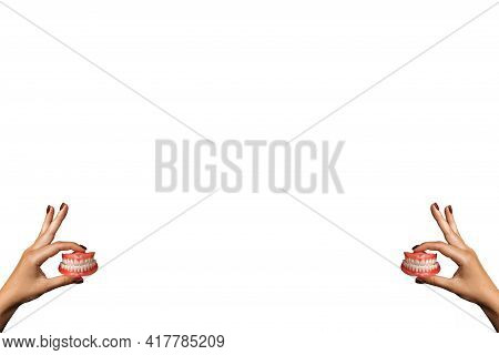 Full Removable Plastic Denture Of The Jaws. Set Of Dentures On A White Background. Two Acrylic Dentu