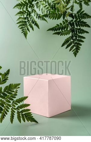 Pastel Pink Podium To Show Cosmetic Products With Fern Leafs On Green Background. Modern Still Life.