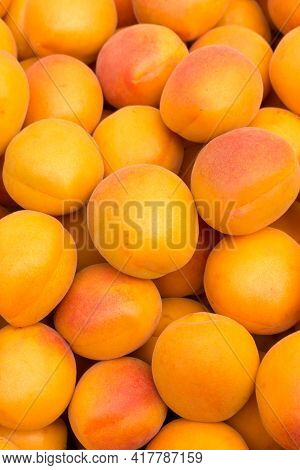 Ripe Apricots On The Market. Background Of Apricots Close-up.