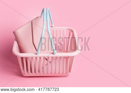 Colorful Plastic Shopping Baskets With Leather Wallet. Empty Pink And Blue Supermarket Basket On Pin
