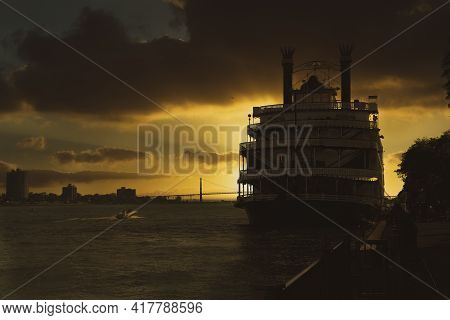Detroit, Michigan -usa- June 29, 2019: Detroit Princess Riverboat Is Docked In A Vibrant Sunset On T